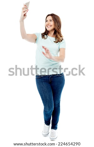 Happy woman taking selfies with her smart phone - stock photo