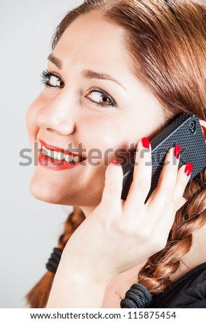 happy woman talking on cellphone - stock photo
