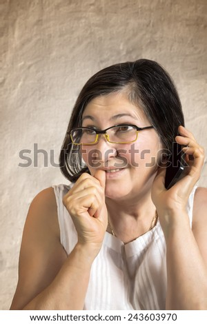 Happy woman talking on cellphone making surprised expression. Think to the solution - stock photo