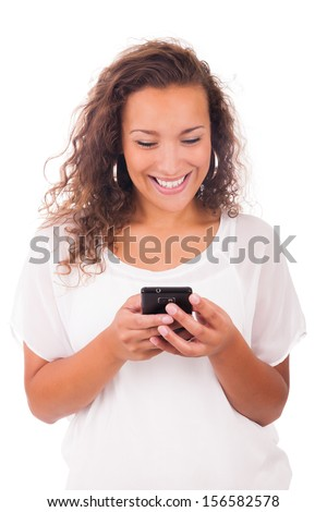 Happy woman texting on her phone isolated over white background