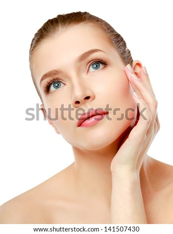 Happy woman touching her face isolated on whire background - stock photo