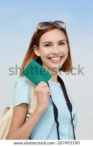 Happy woman tourist travel holding passport isolated on white background, caucasian beauty - stock photo
