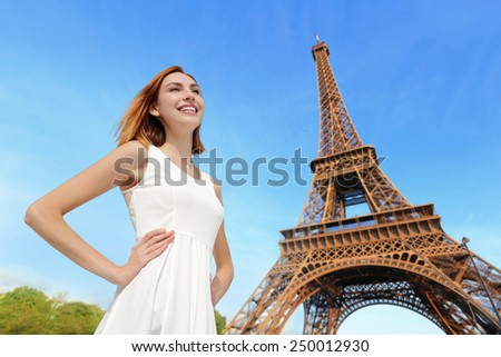 Happy woman tourist travel in Paris with eiffel tower and beautiful blue sky, she feel free and carefree. caucasian beauty - stock photo