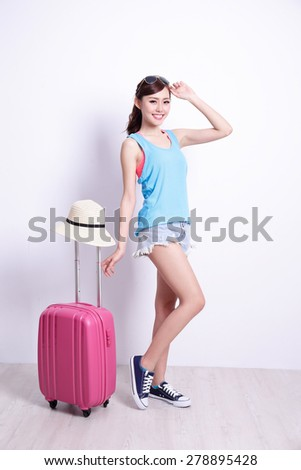Happy woman tourist travel smile to you with white concrete wall and wood floor, asian beauty - stock photo