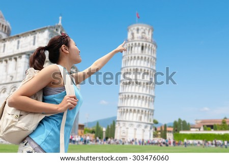 Happy woman travel in Italy, Leaning Tower of Pisa - stock photo