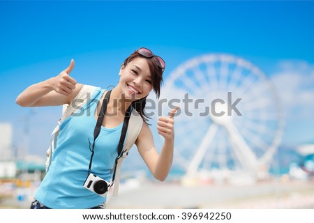 Happy woman travel with ferris wheel, hong kong, asian beauty - stock photo