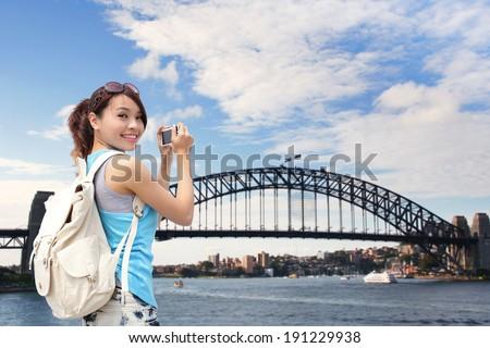 Happy woman traveler photo by camera in Australia  - stock photo