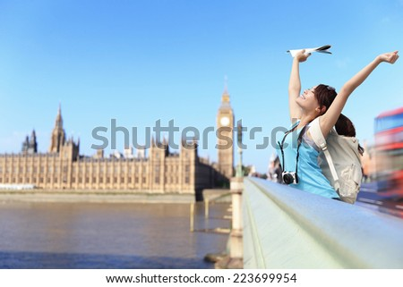 Happy woman traveler relax feel free in London with Big Ben tower,  London, UK, asian beauty - stock photo