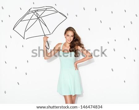 Happy woman under drawn rain and drawn umbrella  - stock photo