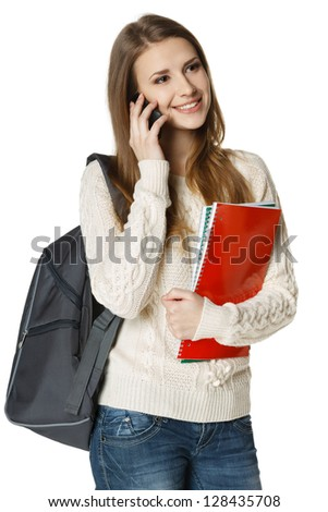 Happy woman university student with backpack and books talking on cell phone, looking out of frame, isolated on white background - stock photo