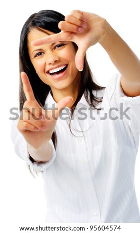 Happy woman uses fingers as a border, isolated on white - stock photo