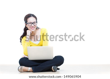 Happy woman using a laptop computer  - stock photo