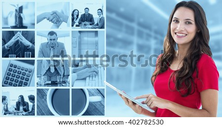 Happy woman using tablet against modern room overlooking city - stock photo