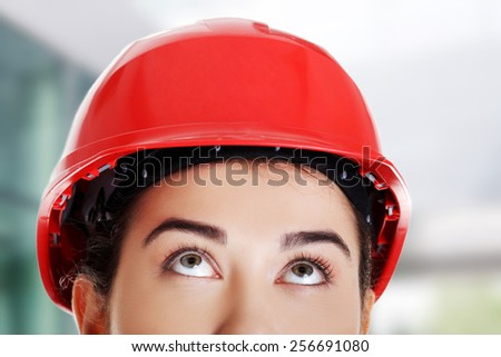 Happy woman wearing a helmet - stock photo