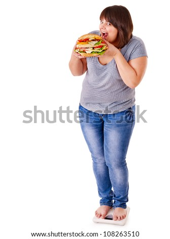Happy woman weight loss on white scales. Isolated. - stock photo
