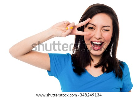Happy woman winking and having fun