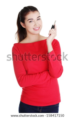 Happy woman with a car key. Isolated on white.  - stock photo