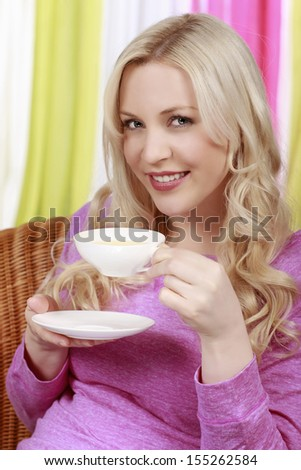 Happy woman with a cup of tea - stock photo