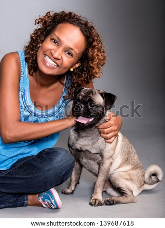 Happy woman with a cute dog smiling - stock photo