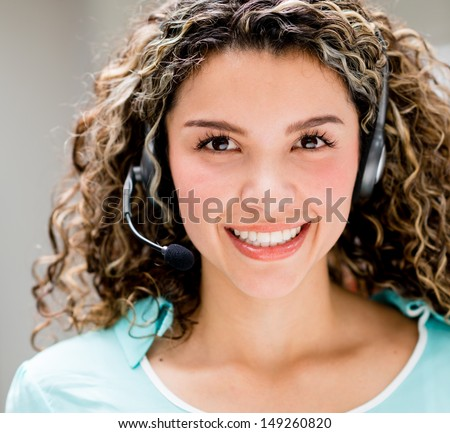 Happy woman with a headset - telemarketing agent concepts  - stock photo
