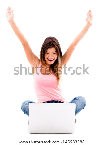 Happy woman with a laptop and arms up - isolated over white background  - stock photo