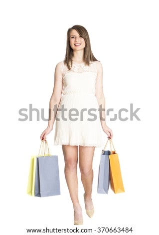 Happy Woman With a Shopping Bags Isolated on white