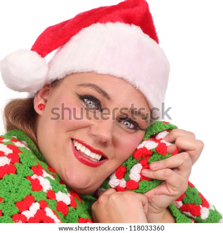 Happy woman with a work handmade blanket - stock photo