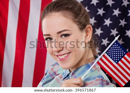 Happy woman with american flag, independence day concept