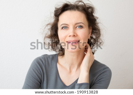 Happy woman with attractive smile looking into camera - stock photo