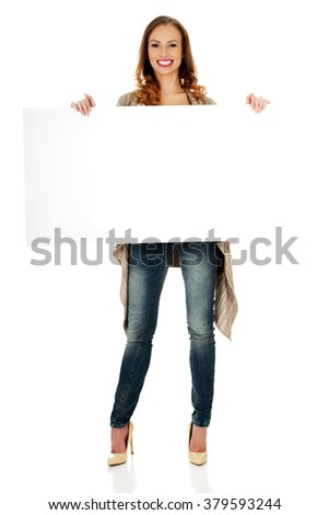 Happy woman with blank board. - stock photo