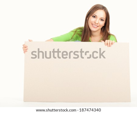 Happy woman with blank board, white background - stock photo