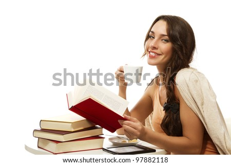 happy woman with books, coffee and ebook on white background - stock photo
