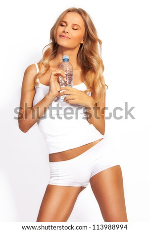Happy woman with bottle of water. Studio white. Vertical - stock photo