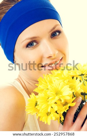 Happy woman with bouquet of yellow flowers - stock photo