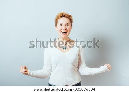 happy woman with fists - stock photo