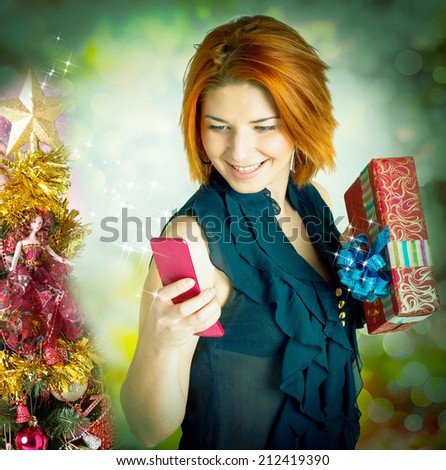 Happy Woman with Gift Box in New Year Night - stock photo