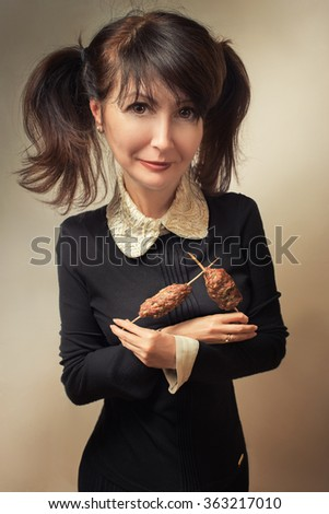 happy woman with grilled meat, doll style image - stock photo