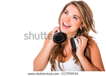 Happy woman with headphones - isolated over a white background