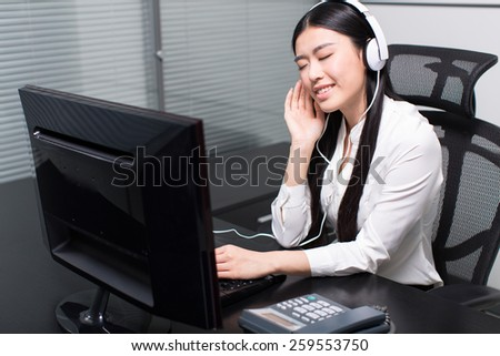 happy woman with headphones listening to music, asia girl. - stock photo
