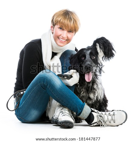 happy woman with her dog cocker spaniel in a studio isolated on a white background