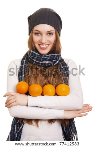 Happy woman with orange on white background - stock photo