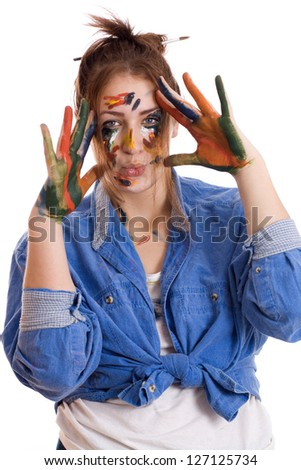 Happy woman with paint smeared hands isolated - stock photo