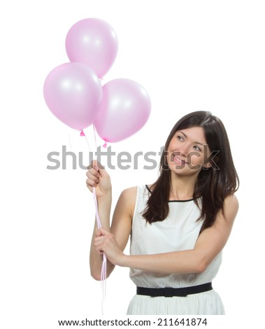 Happy woman with pink balloons as a present for birthday party smiling and looking at the corner on a white background - stock photo