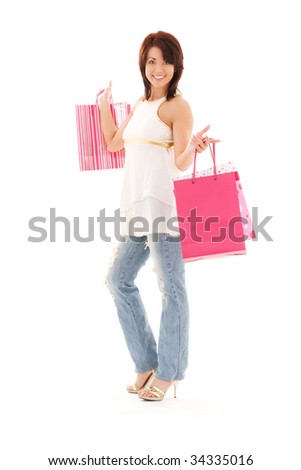 happy woman with pink shopping bags over white - stock photo