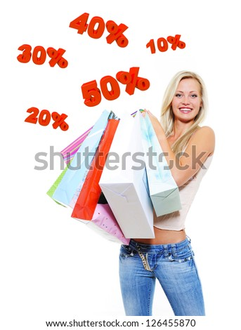 Happy woman with shopping bags isolated on white. Girl standing on 3 dimensional text. - stock photo