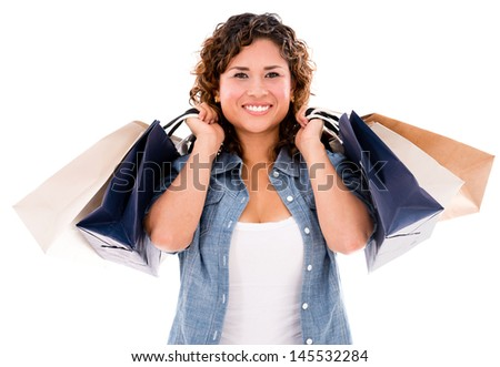 Happy woman with shopping bags - isolated over a white background  - stock photo
