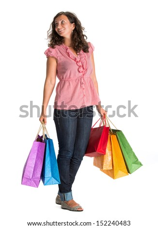 Happy woman with shopping bags on a white background