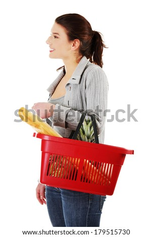 Happy woman with shopping basket , isolated on white background