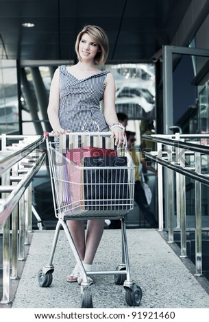 Happy woman with shopping cart
