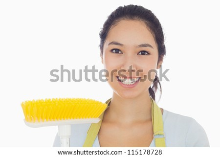 Happy woman with sweeping brush - stock photo